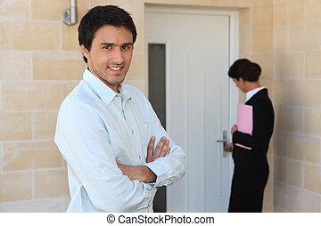 Estate agent showing man around property