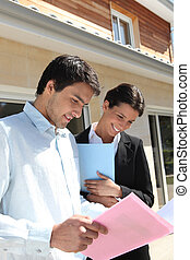 Estate agent with a client