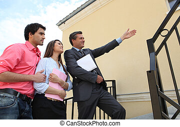 Estate agent with a young couple