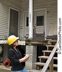 Estimating the Damage - A woman standing in front of an old...