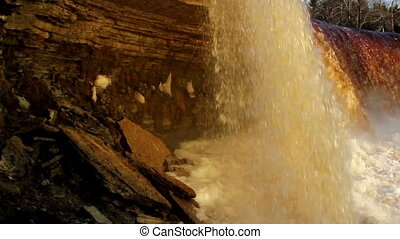 Water falls falling along with a noise