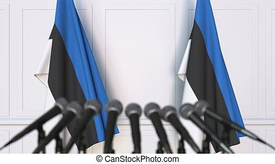 Estonian official press conference. Flags of Estonia and...