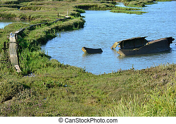 Estuary with ship wreck and path