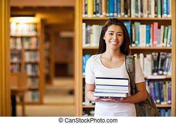 estudante, segurando, livros