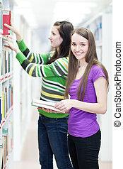 estudantes, dois, biblioteca, jovem, faculdade, bonito