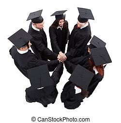 estudantes, empilhando, graduado, mãos