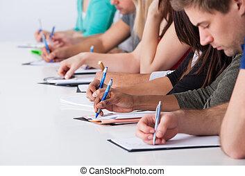 estudantes, universidade, escrivaninha escrito