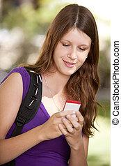 estudiante, con, teléfono celular