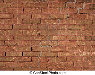 Carved names in Brick wall. Zoom in to read the names
