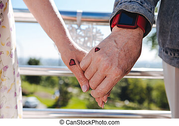 Hands of a positive loving couple