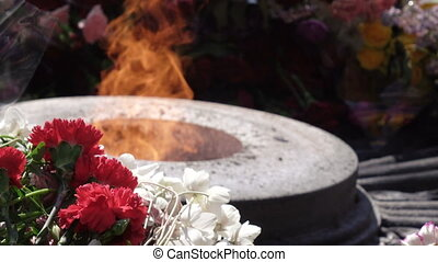 Eternal fire on May 9 - Many flowers around eternal flame...