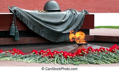 Eternal fire on memorial grave of Unknown soldier of Second World War