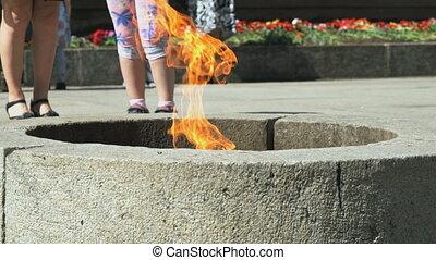 Eternal Flame burning in Velikiy Novgorod Kremlin - People...