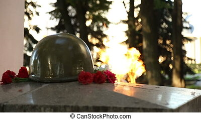 Eternal flame on the monument to unknown soldier
