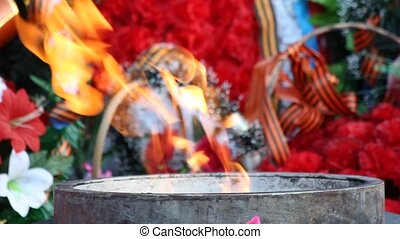 eternal flame - the eternal flame at the monument to fallen...