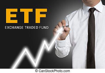 etf trader draws market price on touchscreen.
