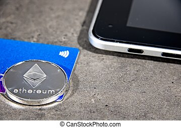 ETH Ethereum coin, tablet and debit card - Shining silver...