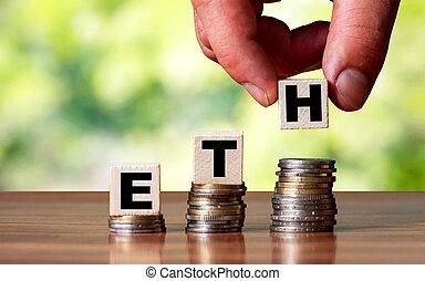 ETH word symbol - business concept. Hands put wooden block ...