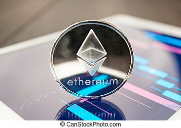 ether cryptocurrency on the tablet - close-up photo of ether...