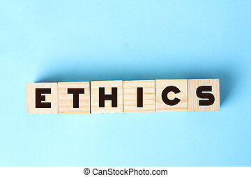 ETHICS word on wooden cubes. Social and business concept