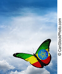 Ethiopia flag butterfly flying on sky background