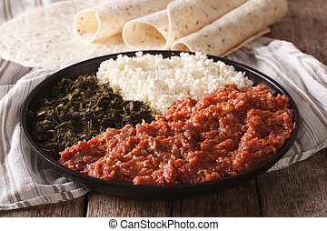 Ethiopian food kitfo: marinated beef with herbs and cheese...