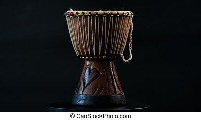 Ethnic african drum called djembe on dark background