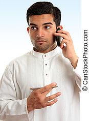 Ethnic business man using phone - Ethnic mixed race...