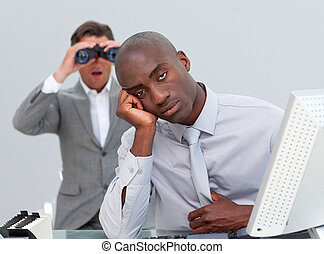 Ethnic businessman getting bored and his manager looking...