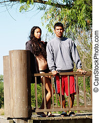 Ethnic Couple Standig At Rail On Dock