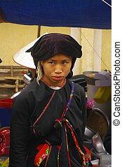 Female Mang Dao ethnicity Xin Man market. Region North Vietnam