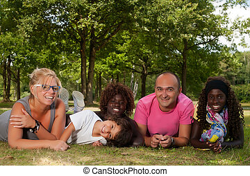 Ethnic family on the grass - Happy multicultural family...