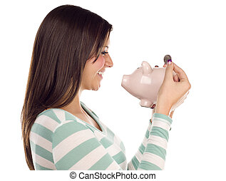 Ethnic Female Putting Coin Into Piggy Bank on White