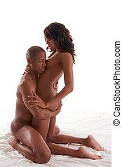 Ethnic heterosexual sensual couple in bed