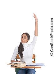 ethnic Indian schoolgirl raised hand in class