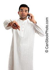 Ethnic man communicating - A mixed race ethnic man...