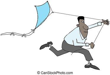 Ethnic man flying a kite