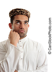 Ethnic man thinking brainstorming - An ethnic man wering a...