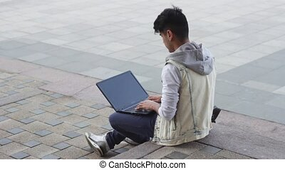 Ethnic man working on laptop