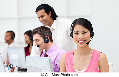 Ethnic manager checking his employee\'s work