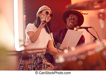 Ethnic Musical Duo Singing in Studio