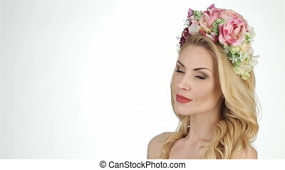 Ethnic portrait of a girl in a flower wreath