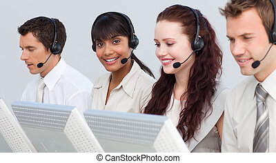 Ethnic woman working with her team in a call center