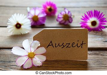 etiqueta, con, texto alemán, auszeit, con, cosmea, flores