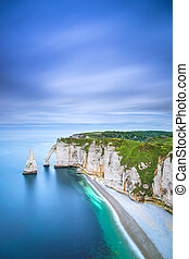 Etretat Aval cliff and rocks landmark and ocean . Normandy, France.