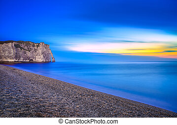 Etretat Aval cliff landmark and its beach. Twilight photography. Normandy, France.
