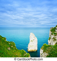 Etretat Aval cliff rock landmark and blue ocean. Aerial view. Normandy, France, Europe.