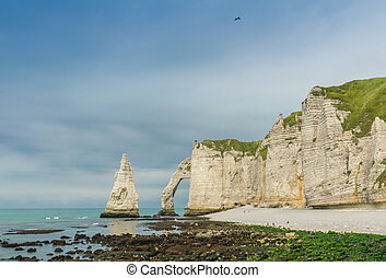 Etretat Aval cliff, rocks and natural arch landmark and blue ocean. Aerial view. Normandy, France, Europe