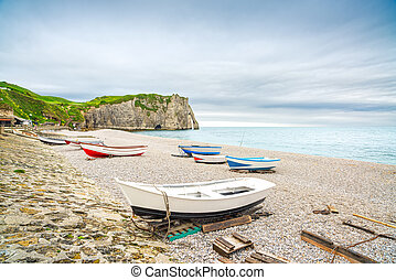 Etretat village, bay beach, Aval cliff and boats. Normandy, France.