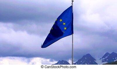 EU flag slowmotion with alpine background